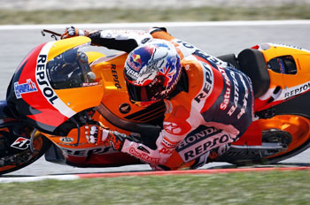 Stoner claims second pole of 2012 season in Spain