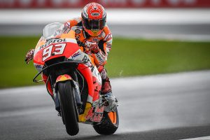 Marquez tops Miller on wet opening day at Valencia